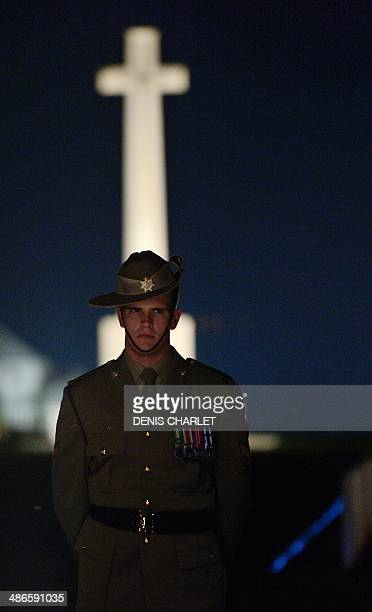 Australian soldier stands during a dawn service at the Australian War Memorial in the northern French city of VillersBretonneux on April 25 to...