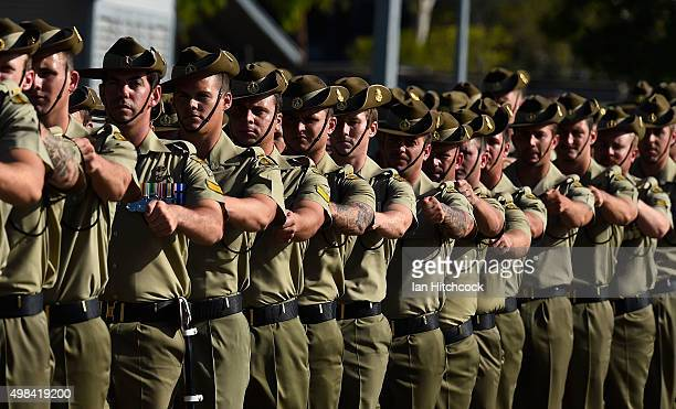 Australian soldiers from the Royal Australian Regiment march onto the parade ground at Lavarack Barracks on November 23 2015 in Townsville Australia...