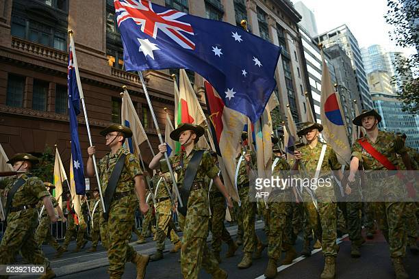 Australian soldiers march during the ANZAC parade to mark the centenary of the Gallipoli landings in Sydney on April 25 2016 Thousands attended...