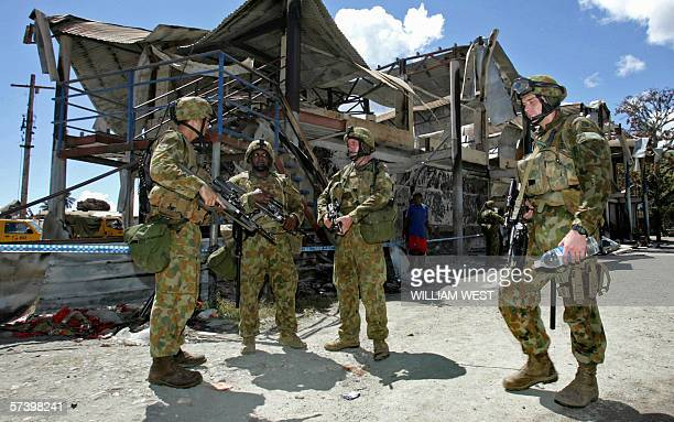 Australian soldiers patrol the streets of Chinatown before Australian Foreign Minister Alexander Downer takes a guided tour around the riotbattered...
