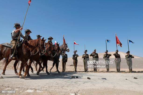 Australian soldiers salute as members of the Australian Light Horse association ride horses on October 29 2017 near BeerSheva on the northern Israeli...