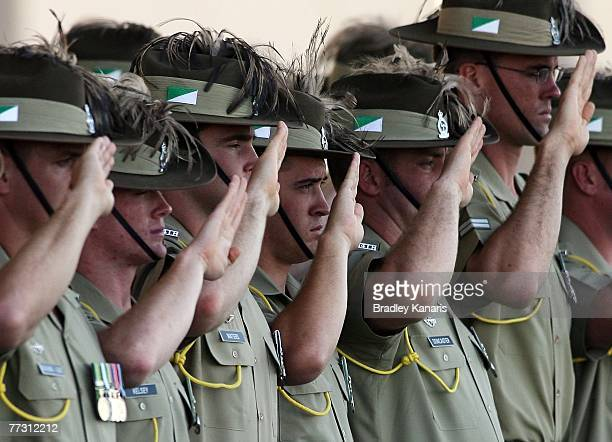 Australian Soldiers salute as the body of deceased trooper David Pearce is carried by troopers during the repatriation ceremony of trooper David...