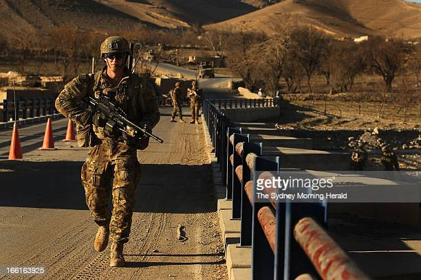 Australian soldiers search for IEDs at the Puza Bridge in Dai Roshan Uruzgan Province Afghanistan January 24 2013 An insurgent was arrested in the...