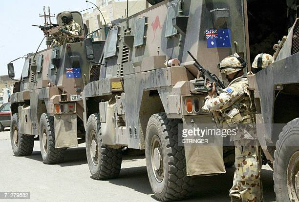 Australian soldiers secure an area in the Iraqi southern city of Samawa 22 June 2006 Japanese British and Australian troops in southern Iraq are...