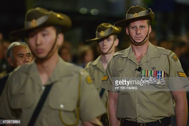 Australian soldiers take part in a dawn service to mark the centenary of the Gallipoli landings in Sydney on April 25 2015 Dawn services were held...