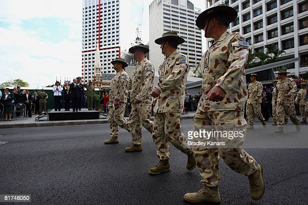 Australian soldiers turn to salute Australian Prime Minister Kevin Rudd at the Queensland Welcome Home Parade on June 28 2008 in Brisbane Australia...
