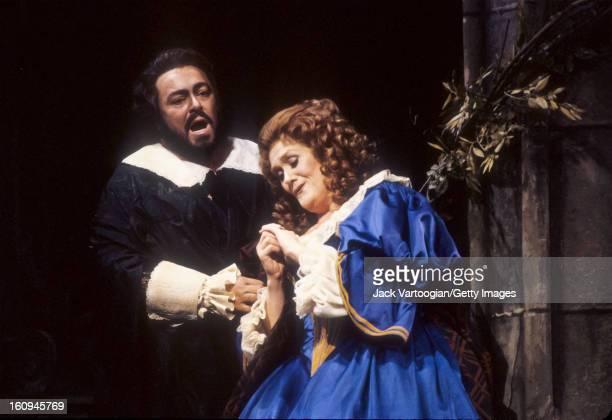 Australian soprano Dame Joan Sutherland and Italian tenor Luciano Pavarotti on stage in the Metropolitan Opera production of Gaetano Donizetti's...