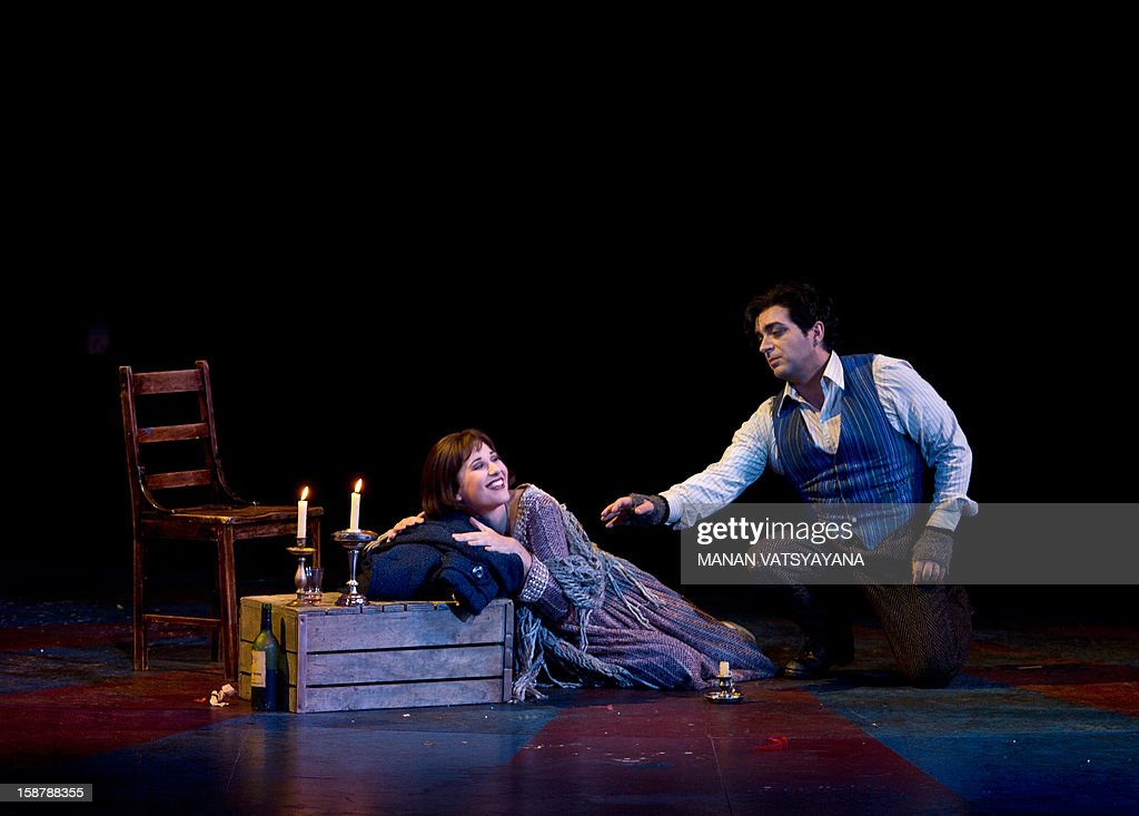 Australian soprano Nicole Car (L) and Italian tenor Gianluca Terranova (R) perform in the roles of Mimi and Rodolfo during a full dress rehearsal for Gale Edward's production 'La Boheme' at the Sydney Opera House on December 29, 2012. Australian Opera director Gale Edward's adaptation of Puccini's La Behome which opens in Sydney on New Years eve, centers on a group of bohemian friends - a poet, a philosopher, a musician and a painter.
