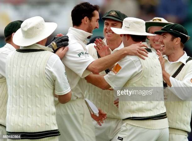 Australian speedster Jason Gillespie celebrates with teammates after bowling New Zealand batsman Matthew Sinclair on the third day of the second Test...