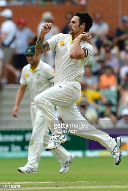 Australian speedster Mitchell Johnson sends down a delivery to the England batsman on the fourth day of the second Ashes cricket Test match in...