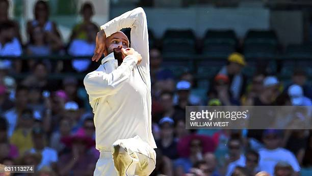 Australian spinner Nathan Lyon sends down a delivery as Australia defeats Pakistan on the final day of the third cricket Test match at the SCG in...