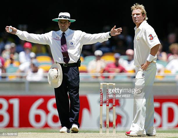 Australian spinner Shane Warne calls bemused as he is repeatly called for bowling wides by umpire Aleem Dar against New Zealand on the second day of...