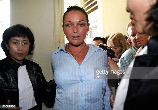 Australian student Schapelle Leigh Corby is escorted by prosecutors into a court room before her trial in Denpasar on Bali Island 27 January 2005...