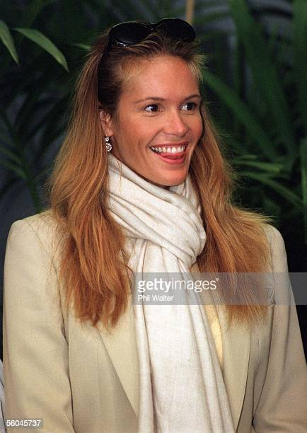 Australian super model Elle MacPherson giggles as she watches the Te Mataarae o Rehua Maori culture group from Rotorua perform upon her arrival at...