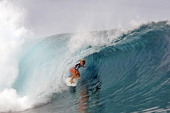 Australian surfer Adrian Bunchan competes on August 18 2013 during the 2013 Billabong Pro Tahiti surf competition in the Hava'e pass off Teahupoo in...