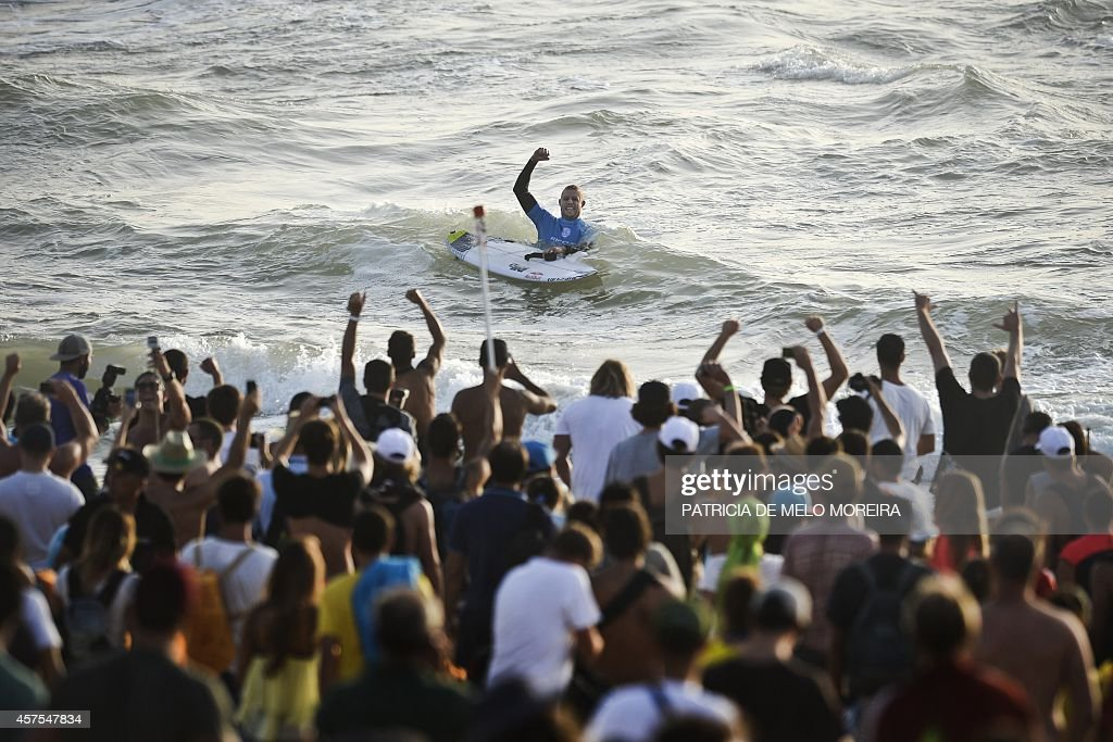 Australian surfer and current World Champion Mick Fanning celebrates his victory over south african Jordy Smith after the Moche Rip Curl Pro Portugal...