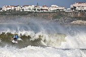 Australian surfer and current world champion Mick Fanning competes in the round 4 heat during the Moche Rip Curl Pro Portugal at Supertubos Beach in...