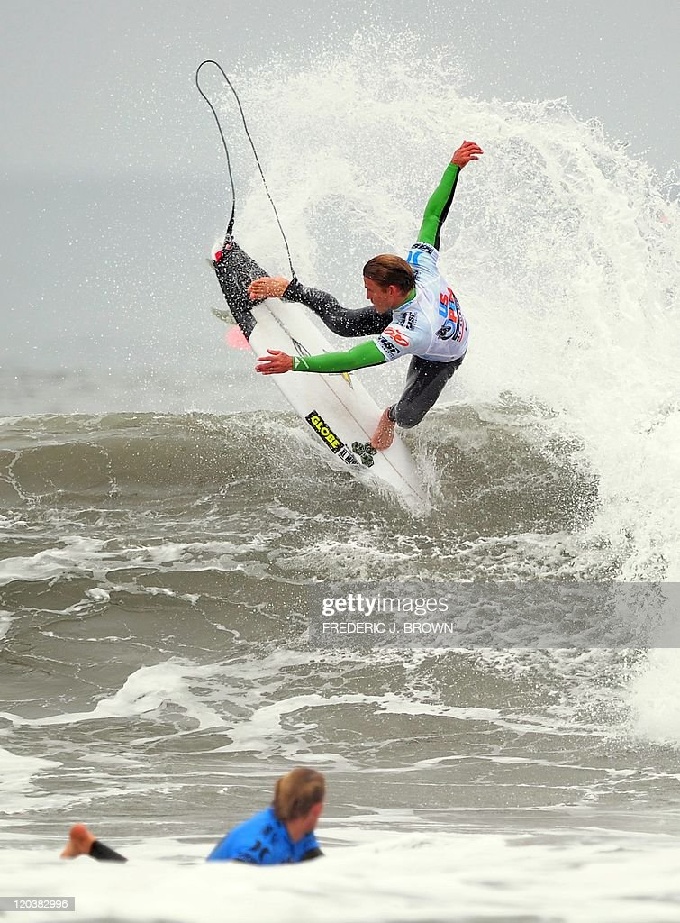 Australian surfer Bede Durbidge watches as compatriot Yadin Nicol competes during round 3 of the men's competition at the US Open of Surfing on...