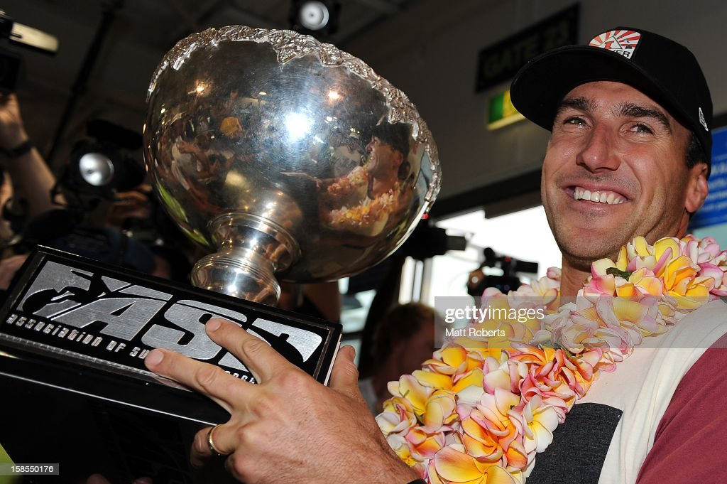 Australian surfer Joel Parkinson arrives home at the Gold Coast airport on December 19, 2012 on the Gold Coast, Australia. Parkinson won the Pipeline Masters and his first ASP World Title on Monday.