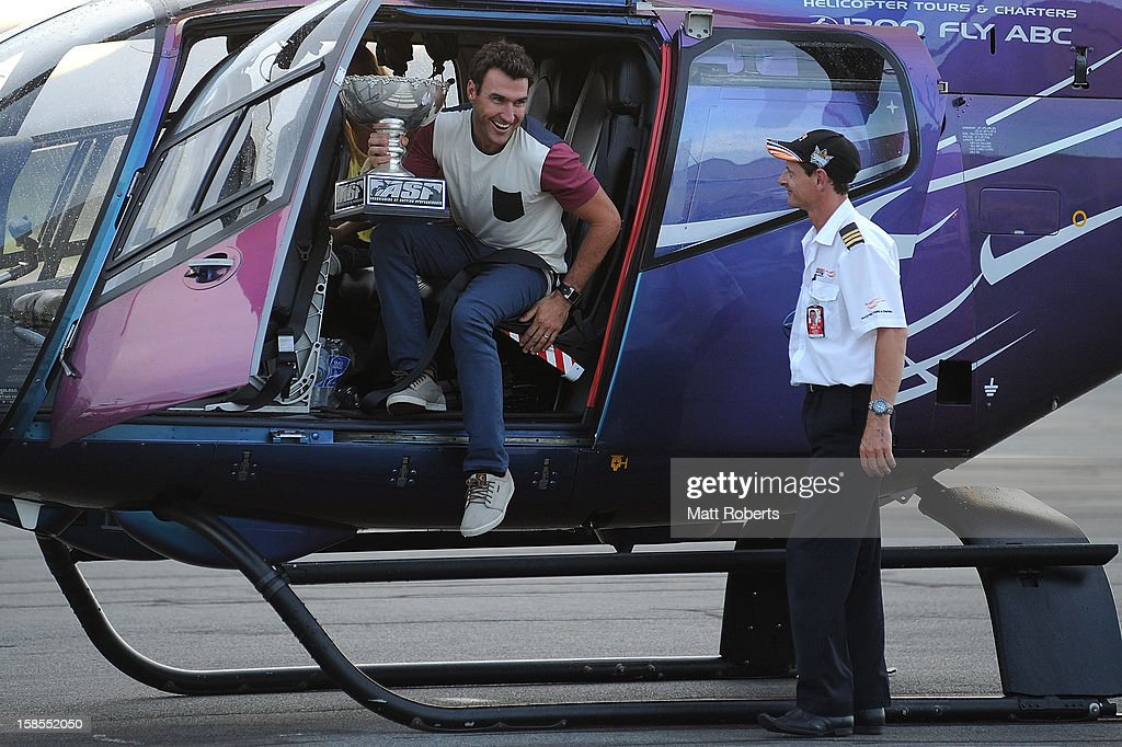 Australian surfer <a gi-track='captionPersonalityLinkClicked' href=/galleries/search?phrase=Joel+Parkinson&family=editorial&specificpeople=234875 ng-click='$event.stopPropagation()'>Joel Parkinson</a> arrives home at the Gold Coast airport on December 19, 2012 on the Gold Coast, Australia. Parkinson won the Pipeline Masters and his first ASP World Title on Monday.