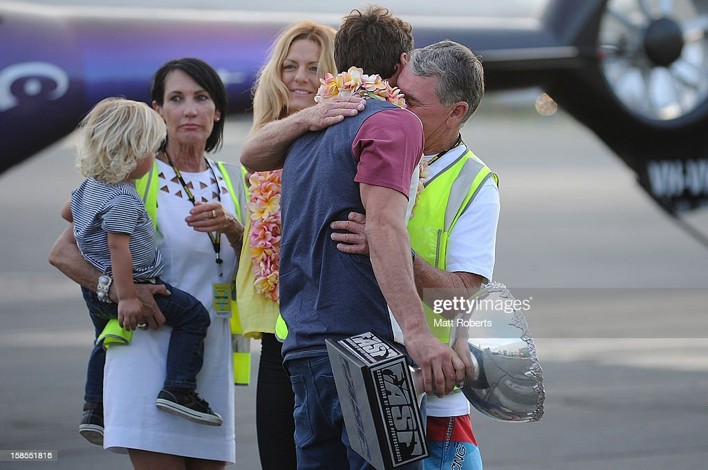 Australian surfer Joel Parkinson hugs is father Bryan as he arrives home at the Gold Coast airport on December 19, 2012 on the Gold Coast, Australia. Parkinson won the Pipeline Masters and his first ASP World Title on Monday.