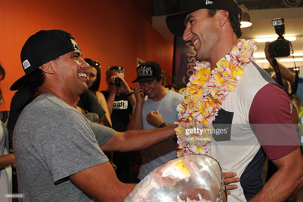 Australian surfer <a gi-track='captionPersonalityLinkClicked' href=/galleries/search?phrase=Joel+Parkinson&family=editorial&specificpeople=234875 ng-click='$event.stopPropagation()'>Joel Parkinson</a> is congratulated by Dean Morrison (L) as he arrives home at the Gold Coast airport on December 19, 2012 on the Gold Coast, Australia. Parkinson won the Pipeline Masters and his first ASP World Title on Monday.