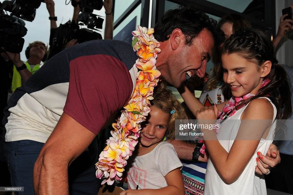 Australian surfer <a gi-track='captionPersonalityLinkClicked' href=/galleries/search?phrase=Joel+Parkinson&family=editorial&specificpeople=234875 ng-click='$event.stopPropagation()'>Joel Parkinson</a> is greeted by his two daughters Evie (R) and Macy as he arrives home at the Gold Coast airport on December 19, 2012 on the Gold Coast, Australia. Parkinson won the Pipeline Masters and his first ASP World Title on Monday.