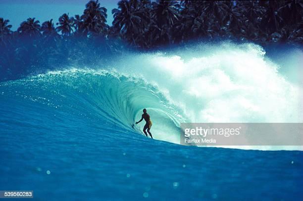 Australian surfer/shaper Dugga Warren riding inside 'the Lime Green Dream' Lagundi bay Nias Island Sumatra Indonesia July 1989 TEH AGE Picture by...
