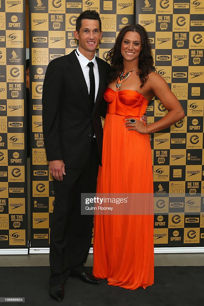 Australian swimmer Blair Evans and partner Ryan Webster arrive at the 2012 Swimmer of the Year Awards at the Melbourne Museum on November 24, 2012 in Melbourne, Australia.