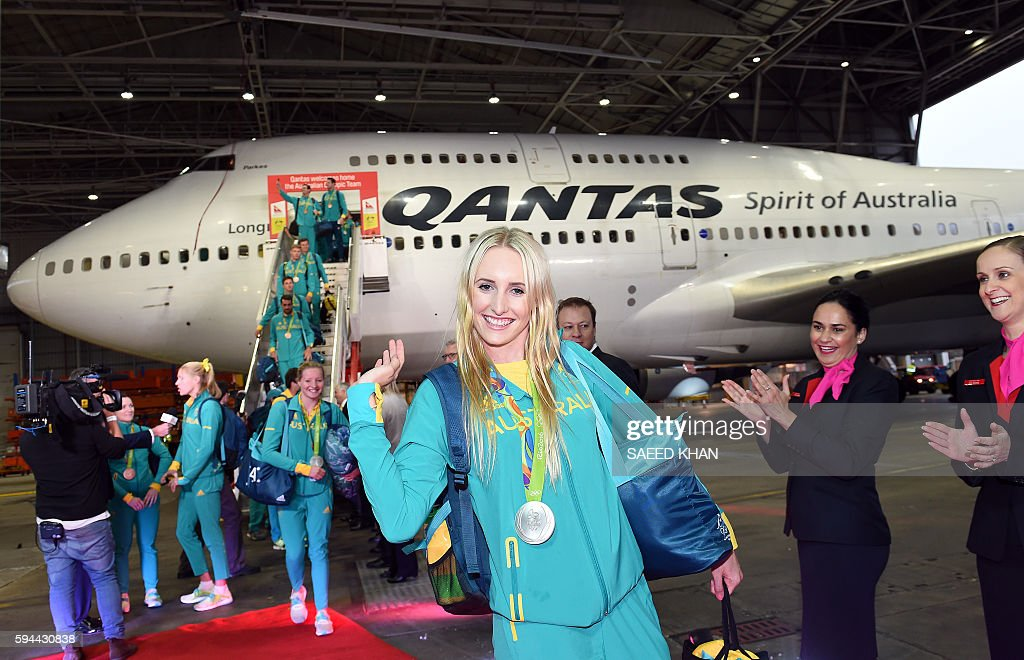 Australian swimmer Taylor McKeown waves as she arrives with other members of the Olympic team in Sydney on August 24 2016 Australia set aside...