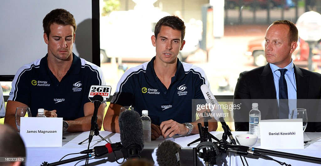 Australian swimmers Eamon Sullivan (C), James Magnussen (L), Australian Swimmers Association CEO Daniel Kowalski (R) and other members of Australia's much-hyped men's Olympic swim relay team dubbed the 'Weapons of Mass Destruction', speak at a press conference after owning up to taking part in 'stupid' pre-Games pranks, in Sydney on February 22, 2013. Members of the 4x100m freestyle relay team led by James Magnussen admitted taking Stilnox sleeping tablets at a training camp in Manchester and then making random prank calls and knocking on their team mates doors. AFP PHOTO/William WEST