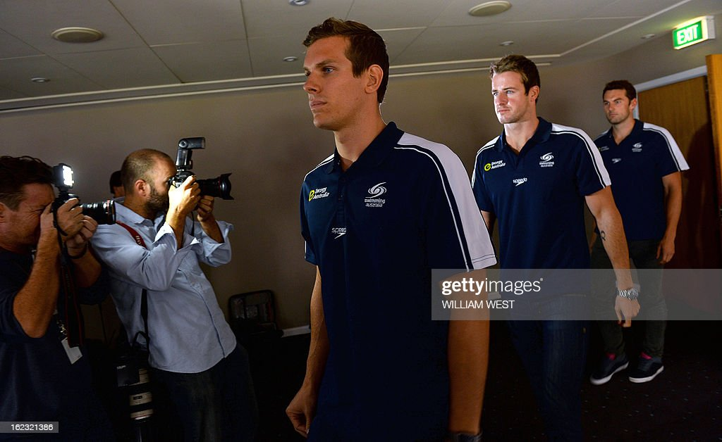 Australian swimmers James Robert (C), James Magnussen (2nd R) and Matt Targett (R), members of Australia's Olympic swim relay team, leave a press conference in Sydney on February 22, 2013. Australia's much-hyped men's Olympic swim relay team, dubbed the 'Weapons of Mass Destruction' before they failed to win a medal, Friday owned up to taking part in 'stupid' pre-Games pranks. AFP PHOTO / William WEST