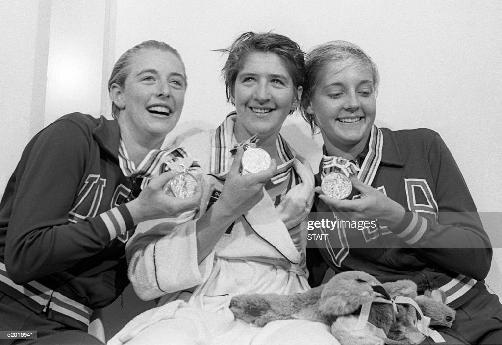 Australian swimming champion Dawn Fraser (C-gold), Sharon Stouder (L-silver) and Ellis (R-bronze) pose with their medals after the Olympic ladies 100m free style that won Dawn Fraser 13 October 1964 in Tokyo, establishing a new 100m record clocking the first ever woman time record under the minute. During her career, Dawn Fraser captured 8 Olympic free style medals (four gold) and beaten 27 world records.