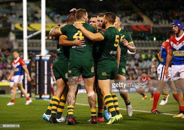 Australian team mates congratulate Wade Graham after scoring one of his tries during the 2017 Rugby League World Cup match between Australian...