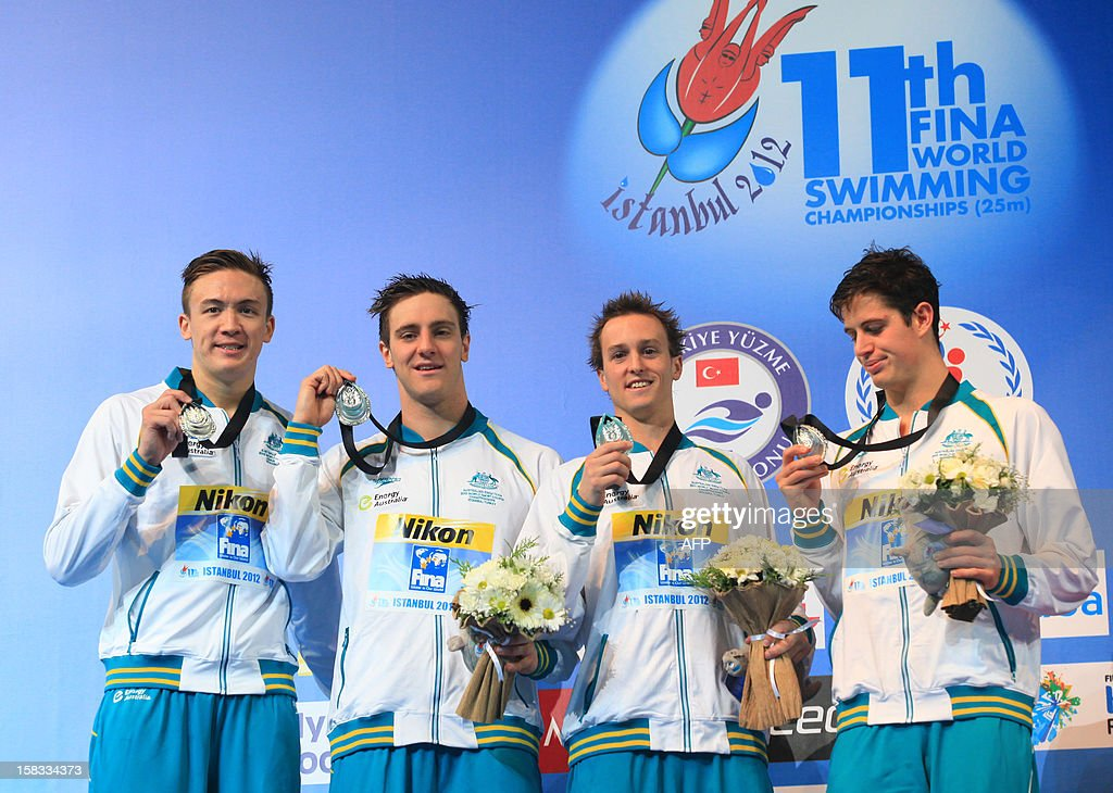 Australian team members pose with their silver medals on the podium after the men's 4x200 freestyle finals on December 13, 2012 during the FINA World Short Course Swimming Championships in Istanbul. AFP PHOTO/MIRA