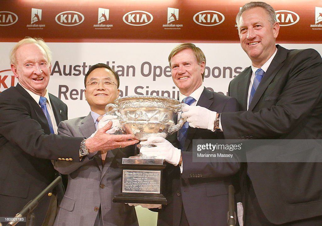 Australian tennis legend Rod Laver joins Kia Motors Corporation Senior Executive Vice President and COO Thomas Oh and Tennis Australia President Steve Healy and CEO Steve Wood and for an official signing ceremony for Kia's five-year major sponsorship renewal during day twelve of the 2013 Australian Open at Melbourne Park on January 24, 2013 in Melbourne, Australia.