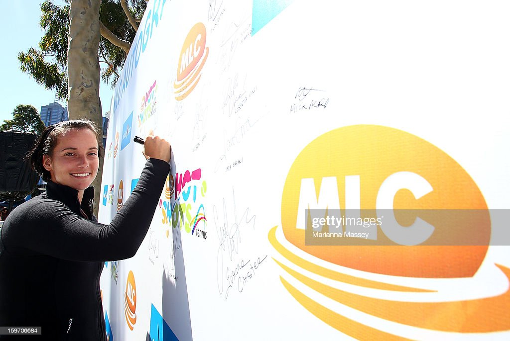 Australian tennis player Jarmila Gajdosova signs autographs for fans during day six of the 2013 Australian Open at Melbourne Park on January 19, 2013 in Melbourne, Australia.