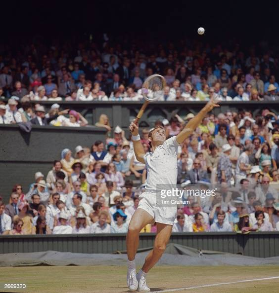 Australian tennis player John Newcombe in action against fellow Australian Rod Laver at the Wimbledon Lawn Tennis Championships Newcombe lost the...