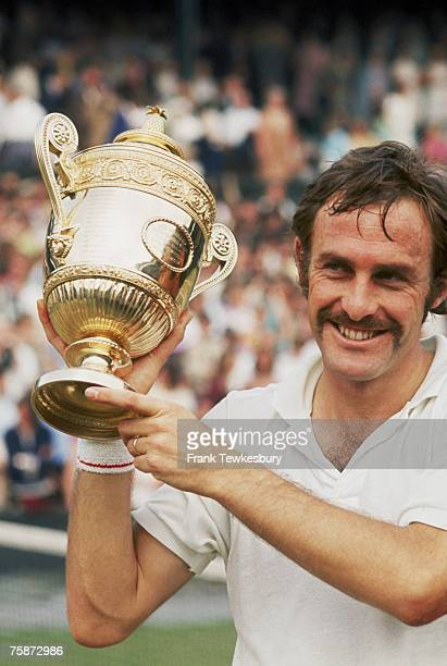 Australian tennis player John Newcombe with the trophy after winning the Men's Singles final against Stan Smith of the USA over 5 sets at the...