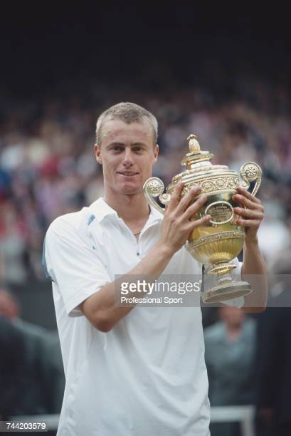 Australian tennis player Lleyton Hewitt holds the Gentlemen's Singles Trophy after beating David Nalbandian of Argentina 61 63 62 in the final of the...