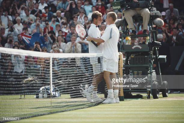 Australian tennis player Lleyton Hewitt shakes hands with his opponent David Nalbandian at the net after beating the Argentine player 61 63 62 in the...