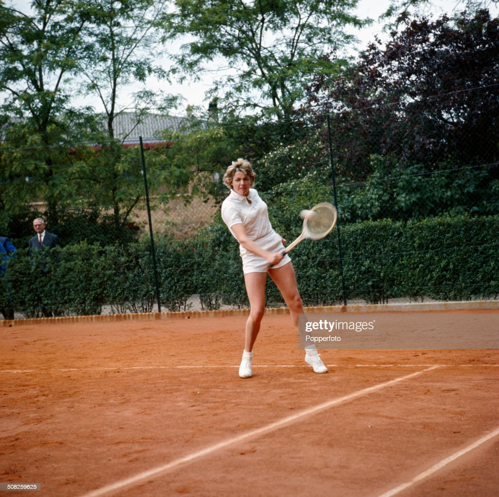 Australian tennis player Margaret Court plays tennis on a clay court in 1965