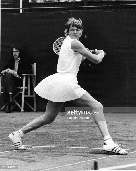 Australian tennis player Margaret Court watches the ball as she winds up for a return during a match in the London Hard Court Championships London...