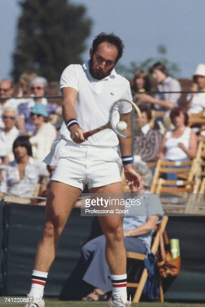 Australian tennis player Mark Edmondson pictured in action in the first round of the Men's Singles tournament at the Wimbledon Lawn Tennis...