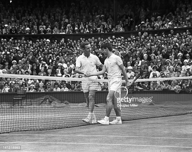 Australian tennis player Martin Mulligan shakes hands with fellow Australian Rod Laver who has just defeated him in the finals of the men's singles...