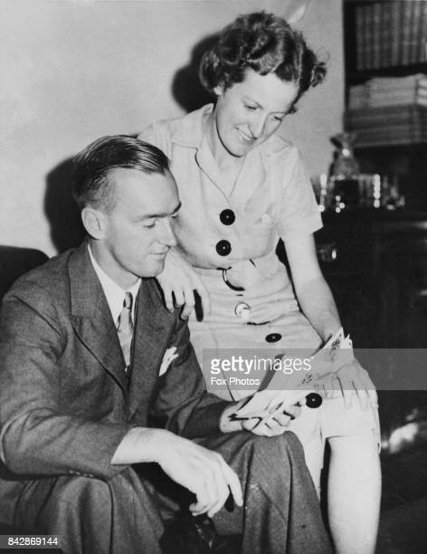 Australian tennis player Nell Hall Hopman and her husband Harry Hopman read congratulatory telegrams at their home in Melbourne Australia 24th...