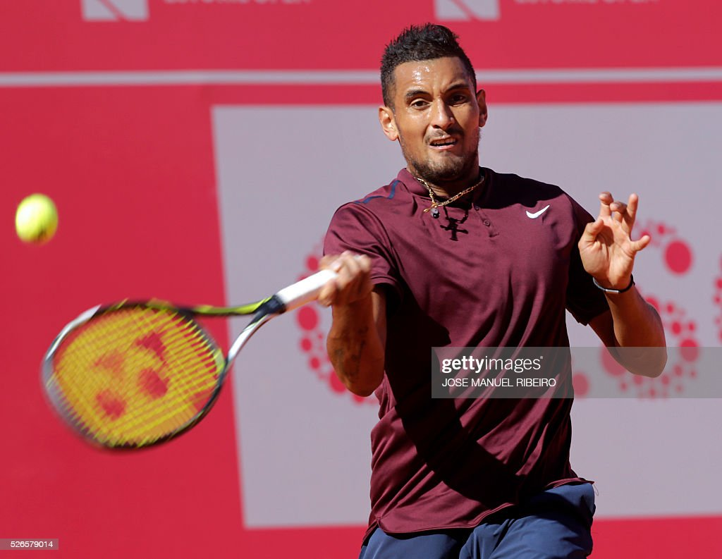 Australian tennis player Nick Kyrgios returns a ball to Spanish player Nicolas Almagro during their semi-final match of the Estoril Open Tennis tournament in Estoril on April 30, 2016. / AFP / JOSE
