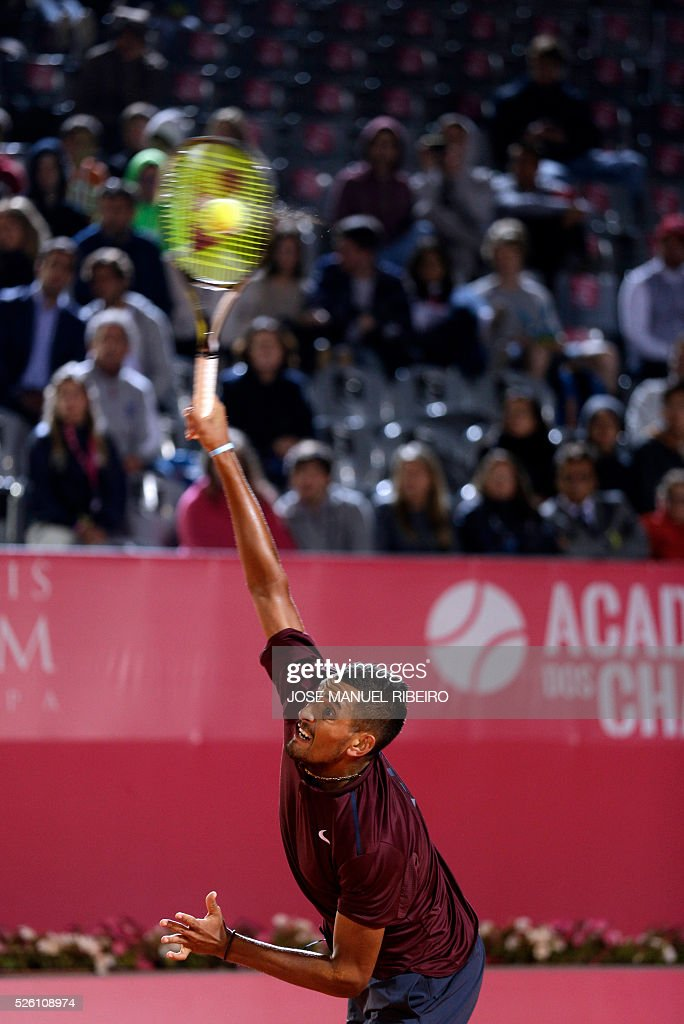 Australian Tennis player Nick Kyrgios serves to Croatian player Borna Coric during their quarter-final Estoril Open Tennis tournament in Estoril on April 29, 2016. / AFP / JOSE