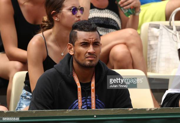 Australian tennis player Nick Kyrgios watches his girlfriend Ajla Tomljanovic as she plays on day two of the 2017 French Open at Roland Garros on May...
