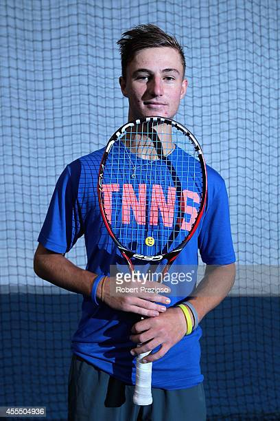 Australian tennis player Omar Jasika poses for photos during a media opportunity at Melbourne Park on September 16 2014 in Melbourne Australia